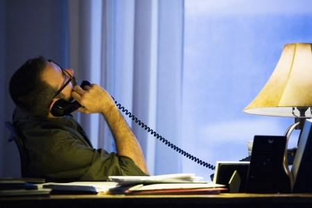 Hispanic businessman talking on telephone Stock Photo - 16095985