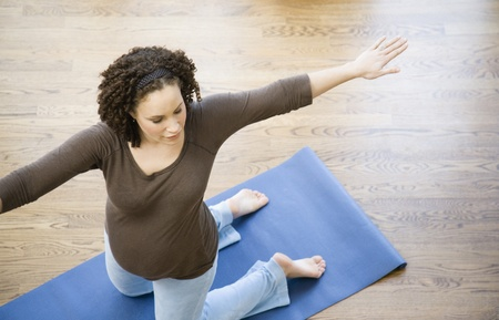 Pregnant African woman practicing yoga Stock Photo - 16095989