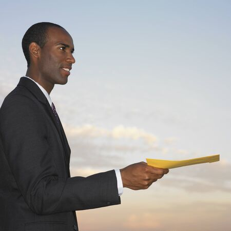 African businessman handing paper Stock Photo - 16096011