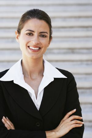 Hispanic businesswoman with arms crossed Stock Photo - 16096045