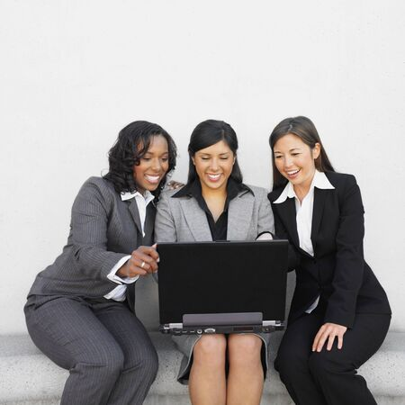 Multi-ethnic businesswoman looking at laptop Stock Photo - 16096048