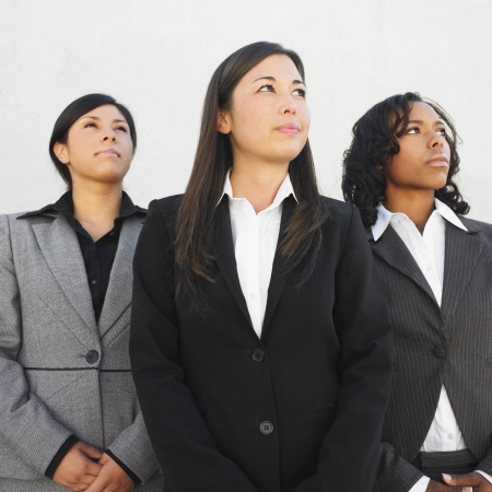 3 persons only: Ethnic-ethnic businesswomen looking up LANG_EVOIMAGES