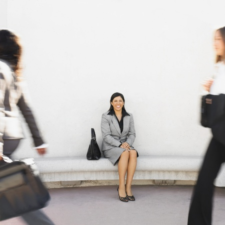 Hispanic businesswoman sitting outdoors Stock Photo - 16096052