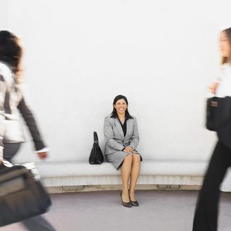Hispanic businesswoman sitting outdoors Stock Photo - 16096052