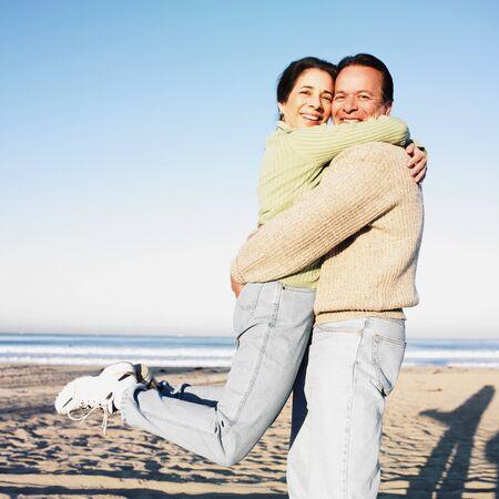 Hispanic couple hugging at beach Stock Photo - 16096062