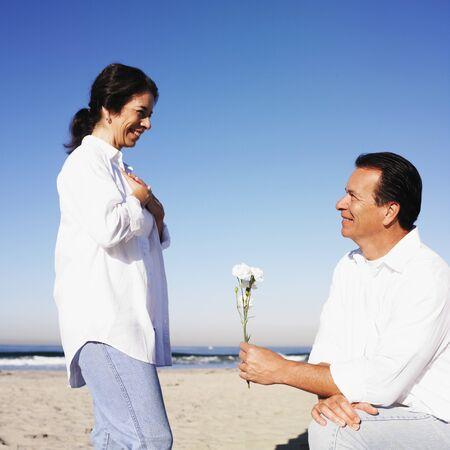Hispanic man giving flower to wife Stock Photo - 16096065