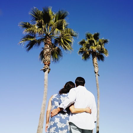 Hispanic couple looking at palm trees Stock Photo - 16096068