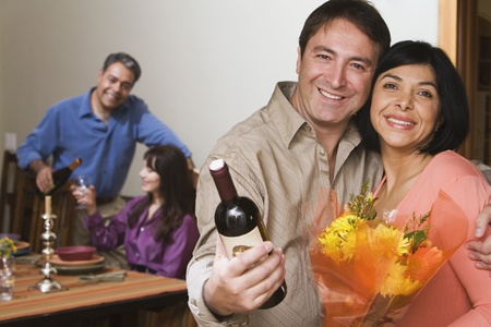Two middle-aged couples at dinner party Stock Photo - 16096088