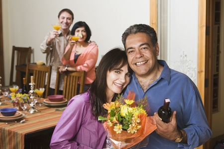 Two middle-aged couples at dinner party Stock Photo - 16096089