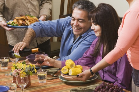 Middle-aged Hispanic couple at dinner party Stock Photo - 16096090