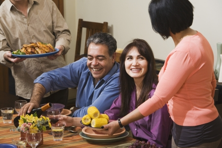 Middle-aged Hispanic couple at dinner party Stock Photo - 16096091