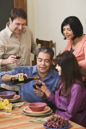 Two middle-aged couples at dinner party Stock Photo - 16096092