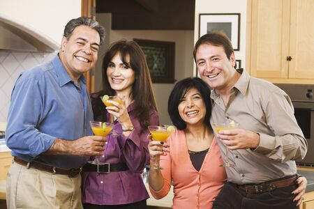 Two middle-aged couples with cocktails Stock Photo - 16096096