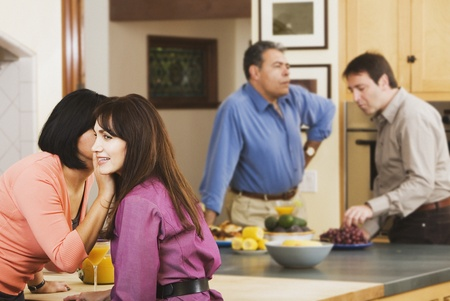 babyboomer: Two middle-aged couples in kitchen LANG_EVOIMAGES