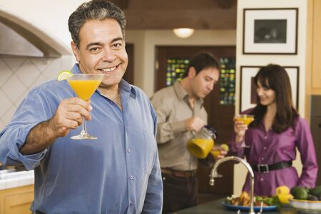 Middle-aged Hispanic man toasting with cocktail Stock Photo - 16096102