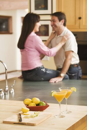 Cocktails in front of multi-ethnic middle-aged couple Stock Photo - 16096105