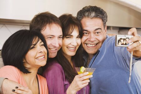 boomers: Multi-ethnic group of friends taking own photograph