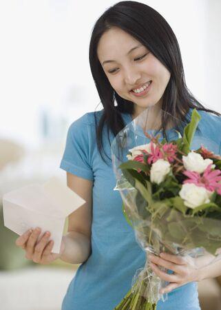 Asian woman receiving flowers Stock Photo