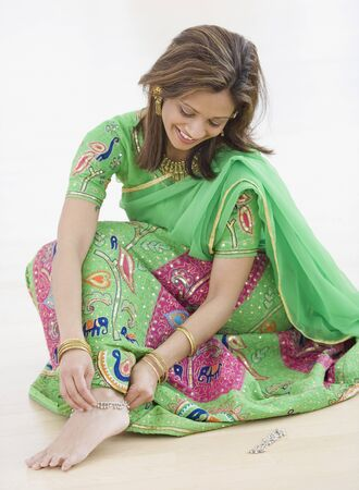anklet: Indian woman wearing traditional dress