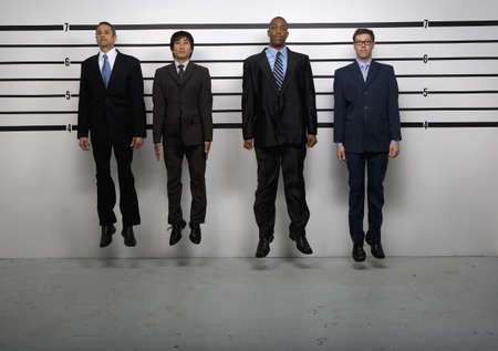full height: Multi-ethnic businessmen jumping in police line up