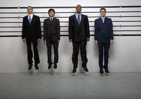 interrogating: Multi-ethnic businessmen jumping in police line up