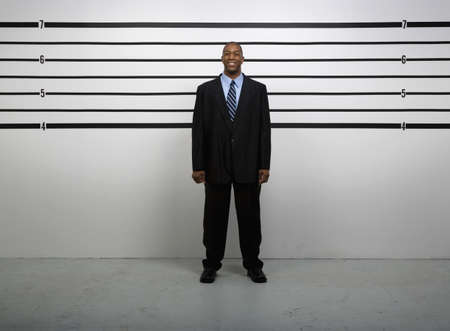 African businessman in police line up Stock Photo - 16096159