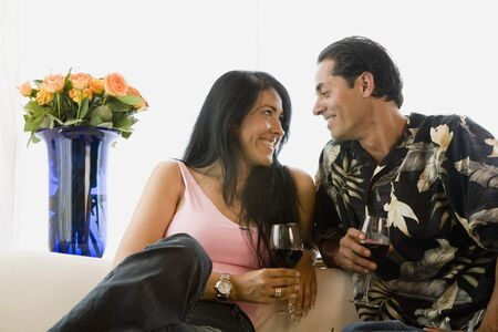 Hispanic couple smiling at each other Stock Photo - 16096164