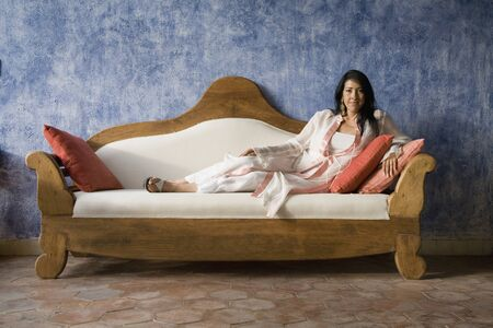 Hispanic woman laying on sofa Stock Photo - 16096165