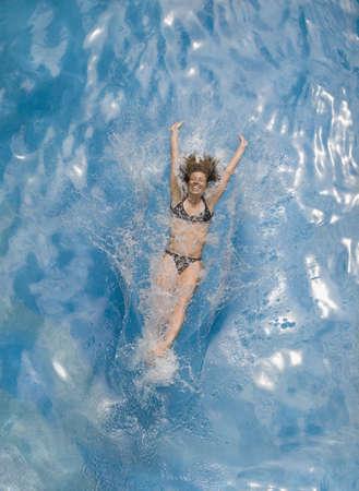 spattering: Woman splashing into water