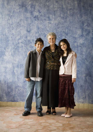 Multi-ethnic grandmother and grandchildren hugging Stock Photo - 16096173