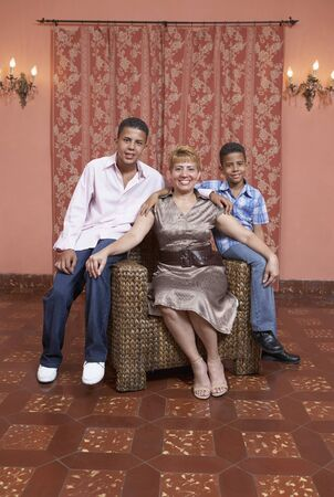 Hispanic mother and sons sitting on chair Stock Photo - 16096204