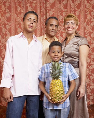 Hispanic family holding pineapple Stock Photo - 16096207