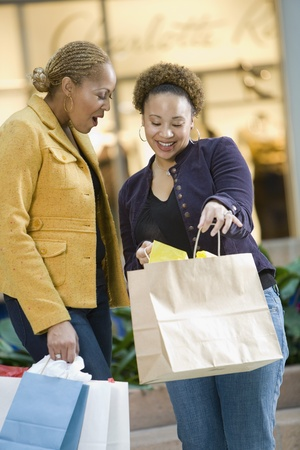 Mixed Race women with shopping bags Stock Photo - 16096208