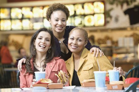 food court: Multi-ethnic women eating in mall