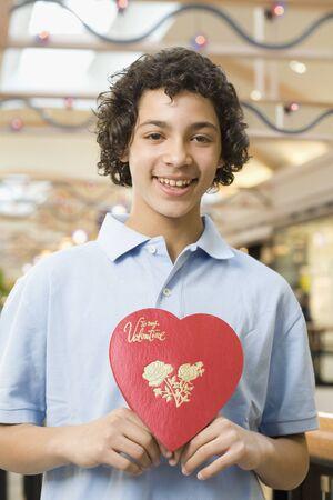 Multi-ethnic teenage boy holding Valentine's Day heart Stock Photo - 16096221