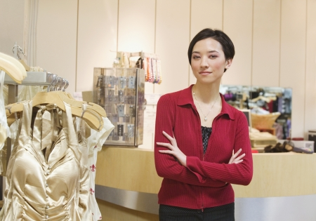 Mixed Race woman working in boutique Stock Photo - 16096223