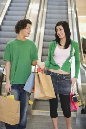 Multi-ethnic teenage couple in mall Stock Photo - 16096225