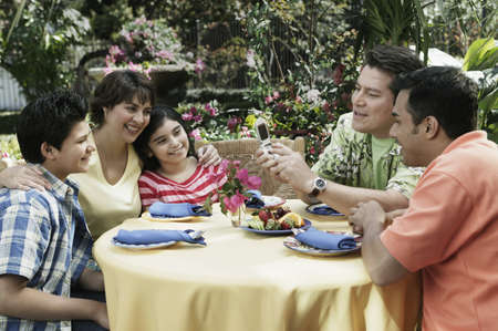 dining out: Hispanic family eating outdoors