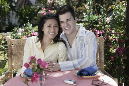 Couple hugging at outdoor table Stock Photo - 16096238