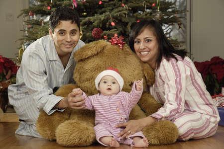 Hispanic parents and baby on Christmas Stock Photo - 16096255