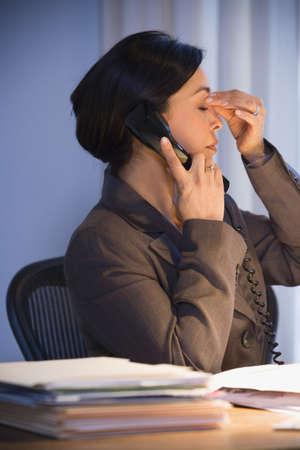 Hispanic businesswoman talking on telephone Stock Photo - 16096261
