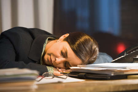 Hispanic businesswoman sleeping on desk Stock Photo - 16096266