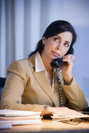 Hispanic businesswoman talking on telephone Stock Photo - 16096268