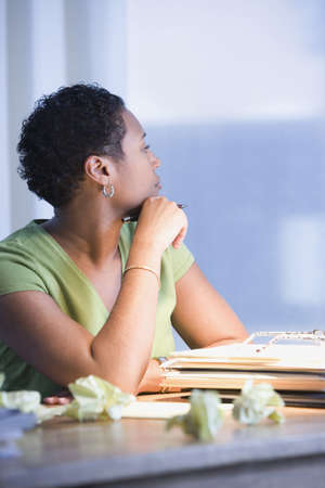 late thirties: African businesswoman thinking