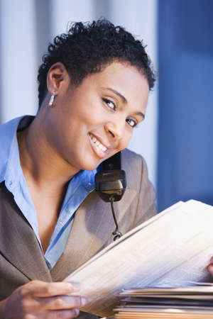 African businesswoman reading newspaper Stock Photo - 16096276