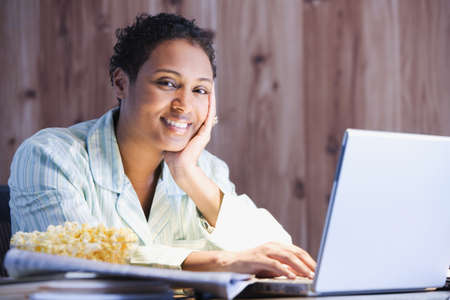 African businesswoman working in pajamas Stock Photo - 16096280