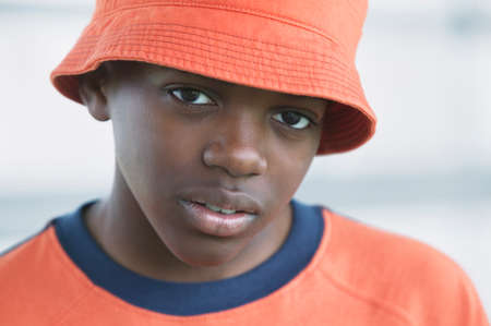 freewill: Portrait of a young boy in orange hat looking at camera