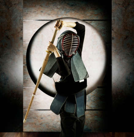 invariable: Person in fencing protective gear holding a stick