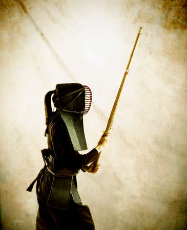 adventuresome: Person wearing protective gear holding a fencing stick