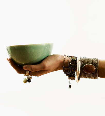 Human hand holding a bowl Stock Photo